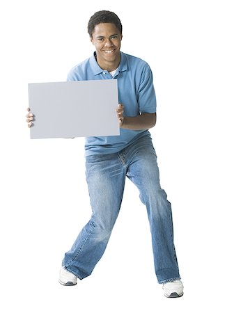 Portrait of a teenage boy holding a blank sign Stock Photo - Premium Royalty-Free, Code: 640-01360939