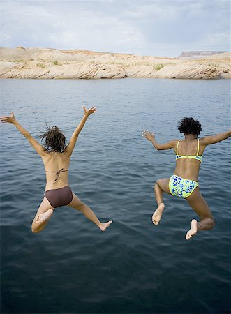 female rear end - High angle view of two young women jumping into a lake Stock Photo - Premium Royalty-Free, Code: 640-01361059
