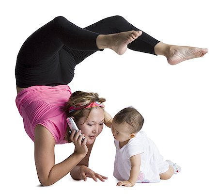 Contortionist mother with baby daughter Stock Photo - Premium Royalty-Free, Code: 640-01361060