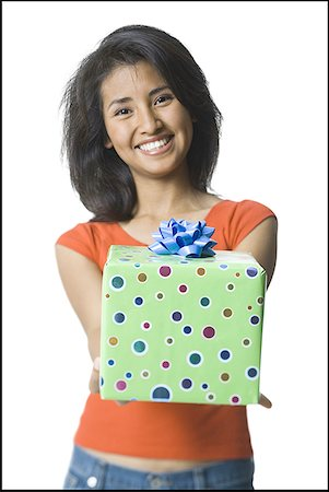 Portrait of a young woman holding a gift Stock Photo - Premium Royalty-Free, Code: 640-01361907