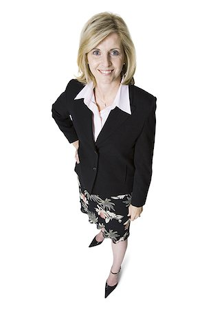 female white background full body - High angle view of a businesswoman smiling Stock Photo - Premium Royalty-Free, Code: 640-01362007