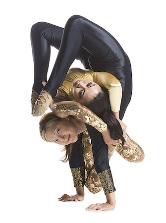 female white background full body - Female contortionist duo performing Stock Photo - Premium Royalty-Free, Code: 640-01362037