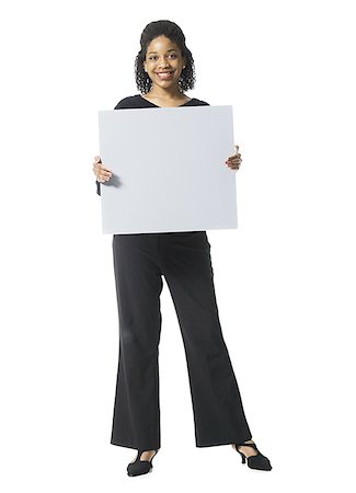 Portrait of a teenage girl holding a blank sign Stock Photo - Premium Royalty-Free, Code: 640-01362176