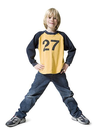 Portrait of a boy standing with hands on hips Stock Photo - Premium Royalty-Free, Code: 640-01362625