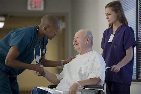 Profile of male doctor shaking hands with a patient Stock Photo - Premium Royalty-Free, Code: 640-01362643