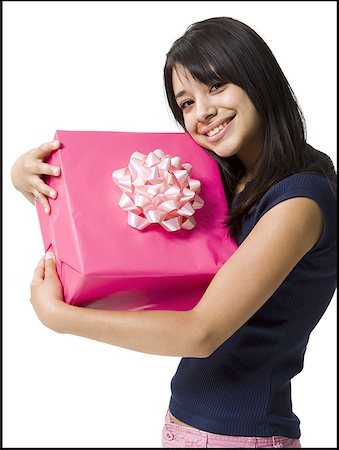 Close-up of a teenage girl holding a gift Stock Photo - Premium Royalty-Free, Code: 640-01363203