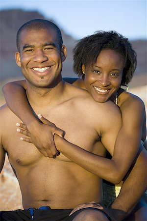 Portrait of a young couple hugging Stock Photo - Premium Royalty-Free, Code: 640-01363413