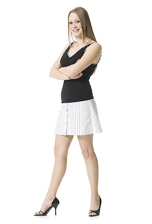 Portrait of a teenage girl standing with her arms crossed Stock Photo - Premium Royalty-Free, Code: 640-01363660