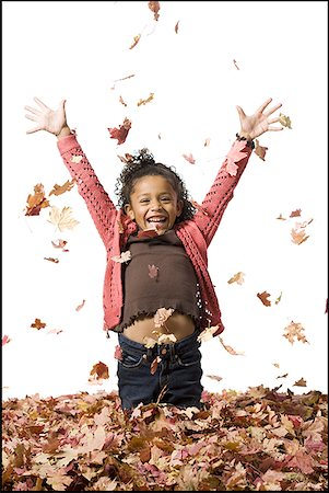 pile leaves playing - Young girl playing in fallen leaves Stock Photo - Premium Royalty-Free, Code: 640-01363770