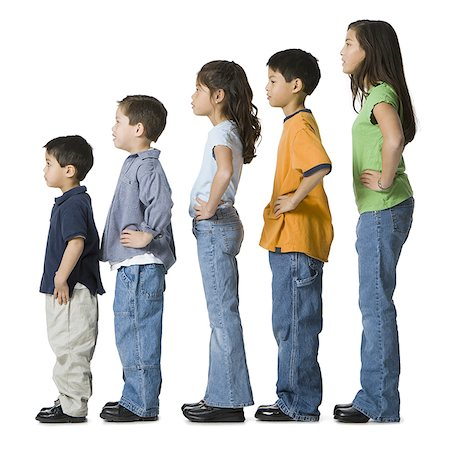 Profile of a children in profile with their hands on their hips Stock Photo - Premium Royalty-Free, Code: 640-01363785