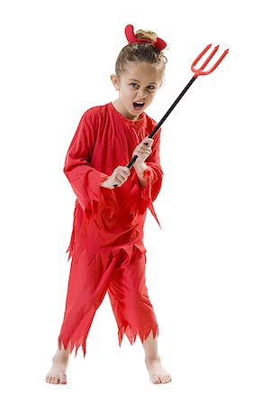 Girl in devil costume Stock Photo - Premium Royalty-Free, Code: 640-01458470