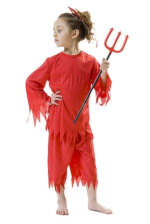 Girl in devil costume Stock Photo - Premium Royalty-Free, Code: 640-01458471