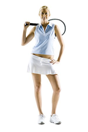 female white background full body - Woman standing with tennis racquet smiling Stock Photo - Premium Royalty-Free, Code: 640-01458488