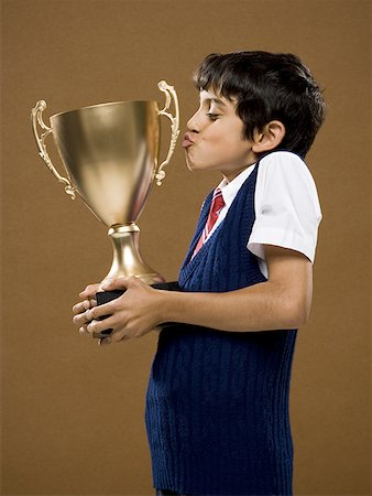 preteen kissing - Boy kissing trophy cup Stock Photo - Premium Royalty-Free, Code: 640-01575083