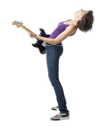 Girl playing electric guitar and singing Stock Photo - Premium Royalty-Free, Code: 640-01601623