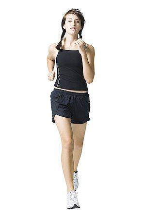Teenage girl jogging Stock Photo - Premium Royalty-Free, Code: 640-01645731