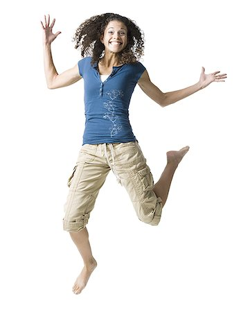 female white background full body - Teenage girl leaping and smiling Stock Photo - Premium Royalty-Free, Code: 640-01645748