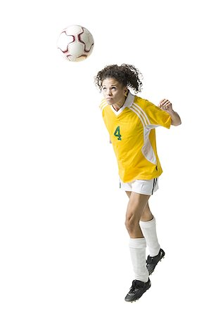 Teenage girl heading soccer ball Stock Photo - Premium Royalty-Free, Code: 640-01645753