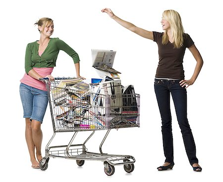 female white background full body - Two teenage girls with shopping cart filled with books and magazines Stock Photo - Premium Royalty-Free, Code: 640-01645850