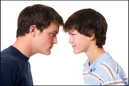 older boy and younger boy head to head. Stock Photo - Premium Royalty-Free, Code: 640-02657550