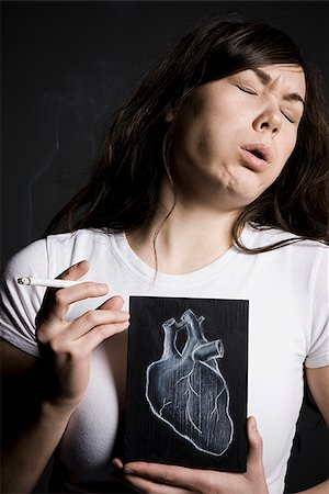 Woman smoker Stock Photo - Premium Royalty-Free, Code: 640-02658467