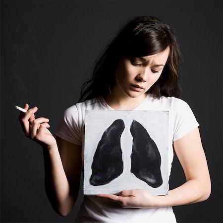 Woman smoker Stock Photo - Premium Royalty-Free, Code: 640-02658463
