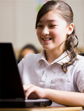 preteen  smile  one  alone - girl with laptop in classroom Stock Photo - Premium Royalty-Free, Code: 640-02658688