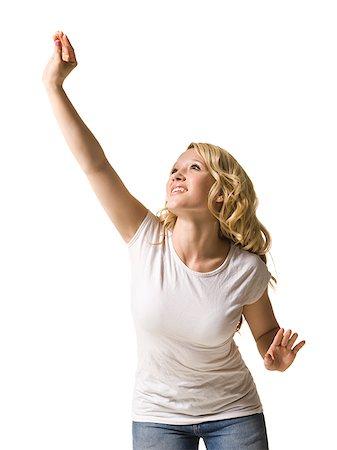 woman reaching up Stock Photo - Premium Royalty-Free, Code: 640-02659299