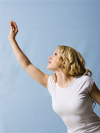 woman reaching up Stock Photo - Premium Royalty-Free, Code: 640-02659301