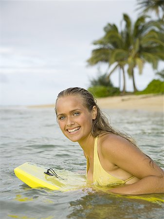 Portrait of a teenage girl on a boogie board Stock Photo - Premium Royalty-Free, Code: 640-02764468