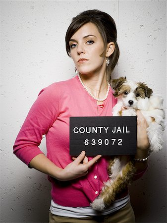 Mug shot of woman with dog Stock Photo - Premium Royalty-Free, Code: 640-02765019