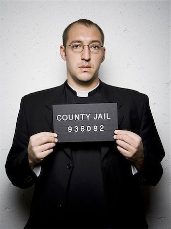 Mug shot of priest with glasses Stock Photo - Premium Royalty-Free, Code: 640-02765012