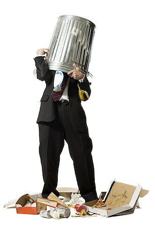 Businessman with trash can on head Stock Photo - Premium Royalty-Free, Code: 640-02765029
