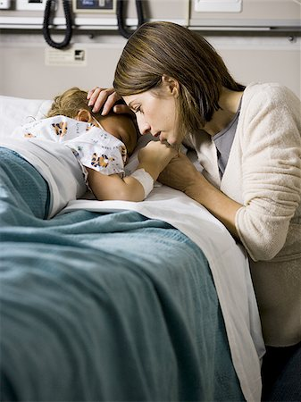 daughter kissing mother - Woman kissing hand of young girl in hospital Stock Photo - Premium Royalty-Free, Code: 640-02765065