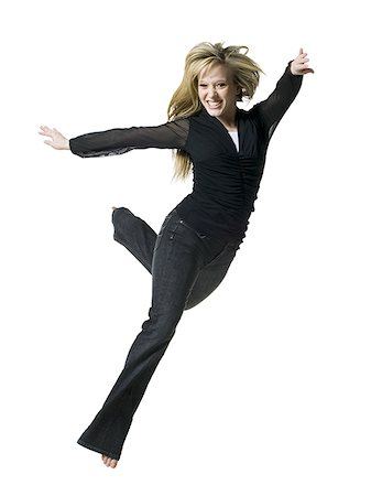 female white background full body - Woman jumping and smiling Stock Photo - Premium Royalty-Free, Code: 640-02765147