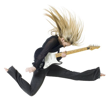 Profile of woman jumping with electric guitar Stock Photo - Premium Royalty-Free, Code: 640-02765143