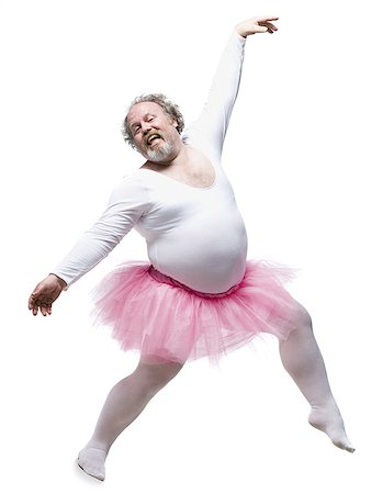 fat man full body - Overweight man in ballerina tutu smiling and dancing Stock Photo - Premium Royalty-Free, Code: 640-02765200