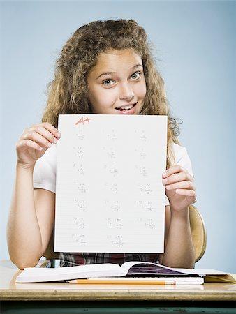 Schoolgirl holding A plus paper Stock Photo - Premium Royalty-Free, Code: 640-02765379