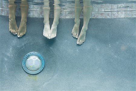 female 16 year old feet - Low section view of three teenage girls feet in a swimming pool Stock Photo - Premium Royalty-Free, Code: 640-02766004