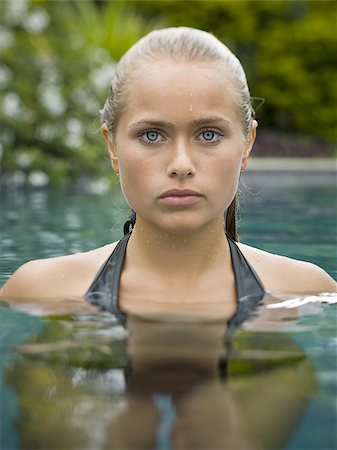Portrait of a teenage girl in a swimming pool Stock Photo - Premium Royalty-Free, Code: 640-02766171