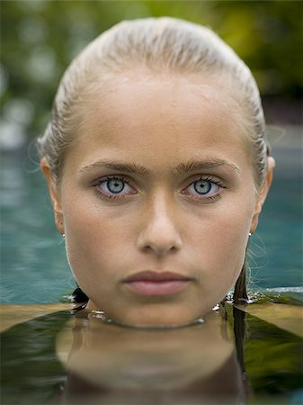 Portrait of a teenage girl in a swimming pool Stock Photo - Premium Royalty-Free, Code: 640-02766173