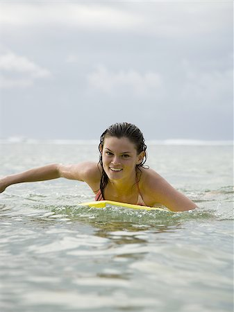 Portrait of a teenage girl floating on a boogie board in the sea Stock Photo - Premium Royalty-Free, Code: 640-02766227