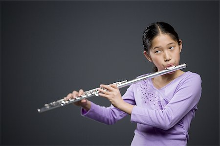 Close-up of a girl playing the flute Stock Photo - Premium Royalty-Free, Code: 640-02766459