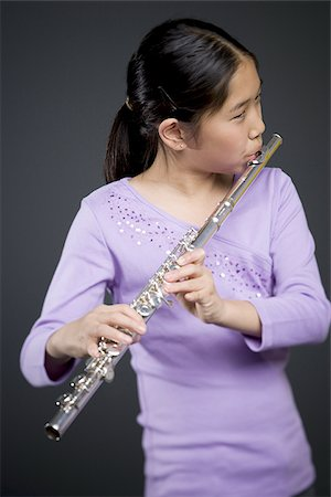 Close-up of a girl playing the flute Stock Photo - Premium Royalty-Free, Code: 640-02766460