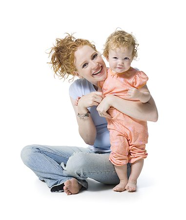 Portrait of a young woman and her daughter smiling Stock Photo - Premium Royalty-Free, Code: 640-02766940
