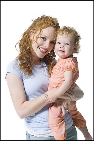 Portrait of a young woman hugging her daughter Stock Photo - Premium Royalty-Free, Code: 640-02766941
