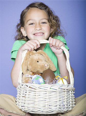 preteen thong - Portrait of a girl holding Easter eggs in a wicker basket Stock Photo - Premium Royalty-Free, Code: 640-02766974