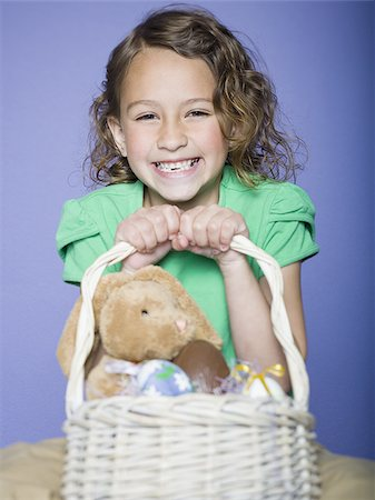 preteen thong - Portrait of a girl holding Easter eggs in a wicker basket Stock Photo - Premium Royalty-Free, Code: 640-02766975