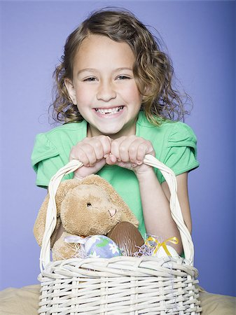 preteen thong - Portrait of a girl holding Easter eggs in a wicker basket Stock Photo - Premium Royalty-Free, Code: 640-02766976