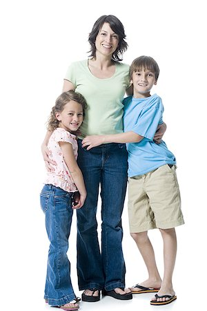 preteen thong - Portrait of a boy and a girl hugging their mother Stock Photo - Premium Royalty-Free, Code: 640-02766986